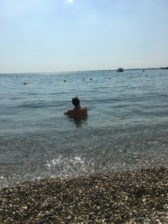 John enjoying the beach near our hotel